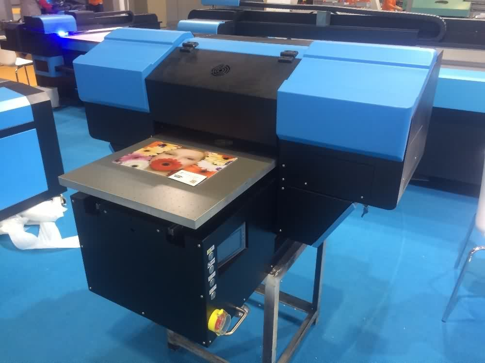 30 Years Factory 450*900mm Flatbed UV printer for phone case printing to Pretoria Factories