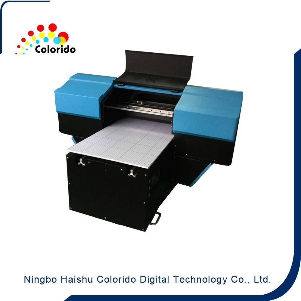 16 Years Factory A4 SizeTabletop Flatbed Inkjet UV-LED Printer to Cologne Importers
