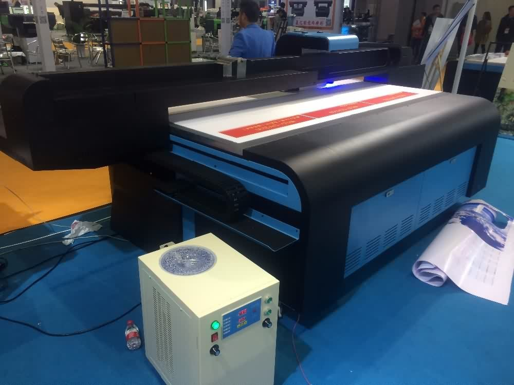 Professional factory selling High speed Industrial UV Flatbed printer, UV2030 Flatbed printer with water cooling system for Suriname Factories